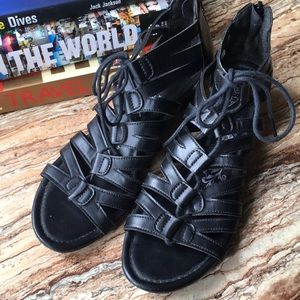 Lace up black gladiator sandals with small heel
